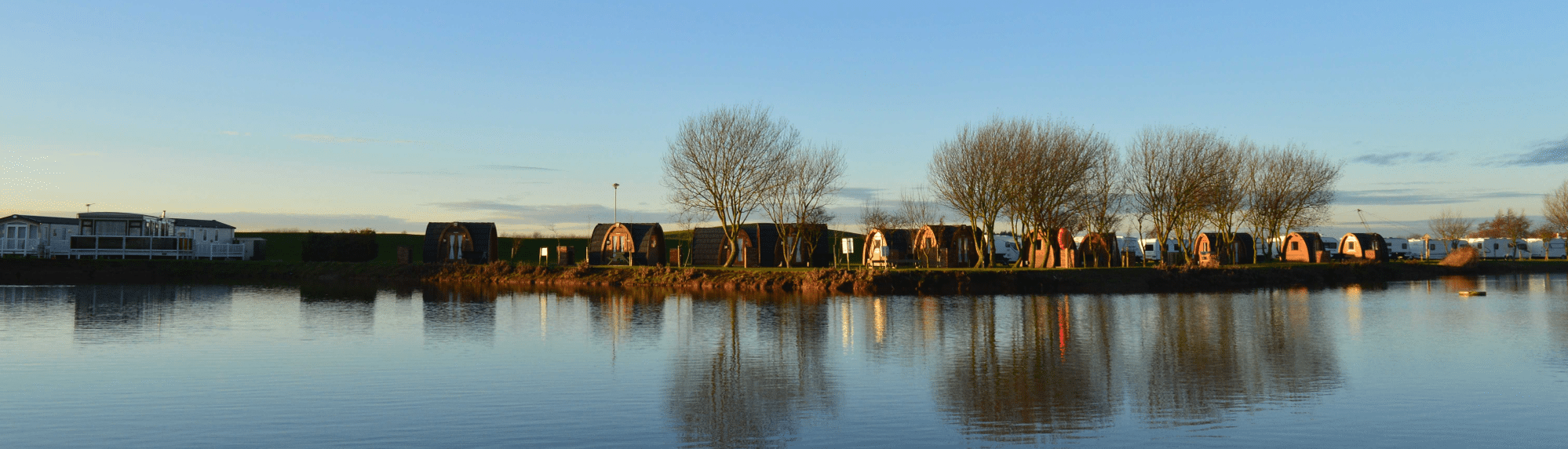 A photo of our lakeside camping pods in the winter months.